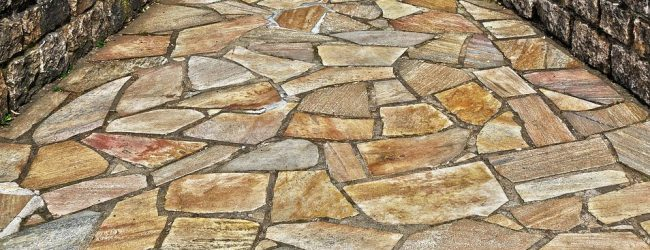A flagstone patio is versatile. The design used can be formal or informal.  Flagstone works over concrete slabs or laid directly on existing stable  soils. - Flagstone Patio Design - Acceleread